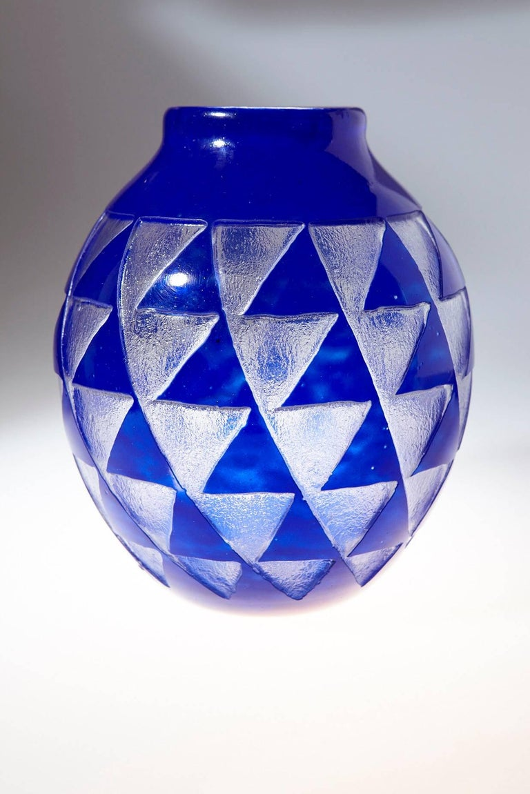 Beautiful French Art Deco glass vase by David Gueron (1892 - 1950) (Degué) for Verrerie d'Art Degué in Paris. The vase is made in a stunning cobalt blue cameo sandblasted glass featuring a geometric pattern of triangles.
