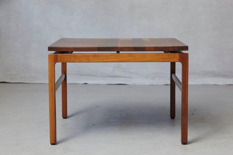 Gunlocke walnut side table, 1960s. The Gunlocke logo on the underside of the table. The table has been newly refinished in November 2017, excellent vintage condition.