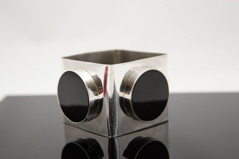 Exceptional vintage silver and onyx bangle. Large square bangle with large circular bezel set onyx stones on three sides. The bangle is being sold as silver plate, but is untested and unmarked.  A beautiful modern 1970s design statement piece, in