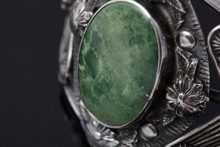 American Sterling Cuff with Large Green Centre Turquoise and Elaborated Reliefs, 1940s For Sale