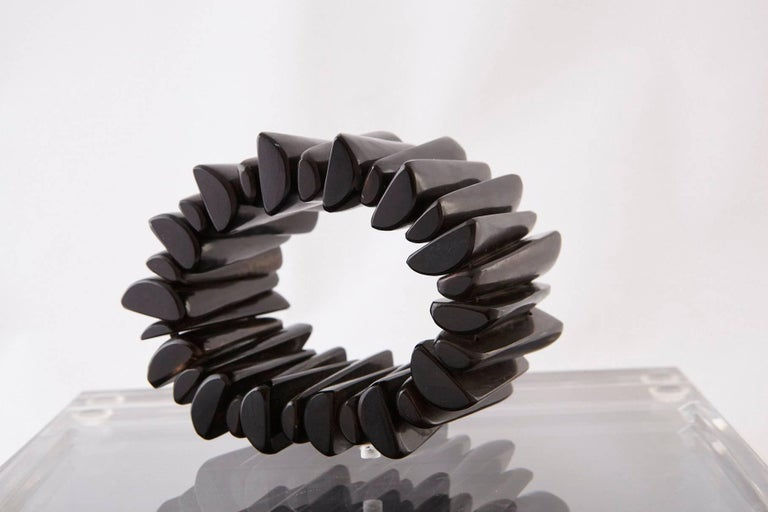 Stunning large modern hand-carved ebony bracelet made from 28 single pieces of ebony.  Measure: Opening 2.25 inches.