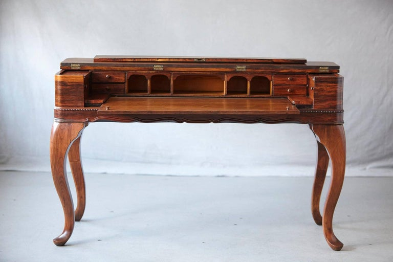 Exceptional late 19th century handcrafted Queen Anne style Rosewood spinet desk with a myriad of drawers, pigeon holes and cupboards mounted on cabriole legs with pad feed. The desk  The desk has been completely restored in December