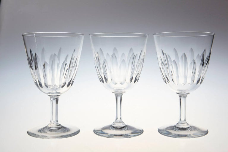 Rare set of ten Baccarat crystal white red glasses in the 'Verone' pattern. The glasses are in a vertical cut bowl form with a six-sided stem. This pattern was manufactured between 1954-1961.