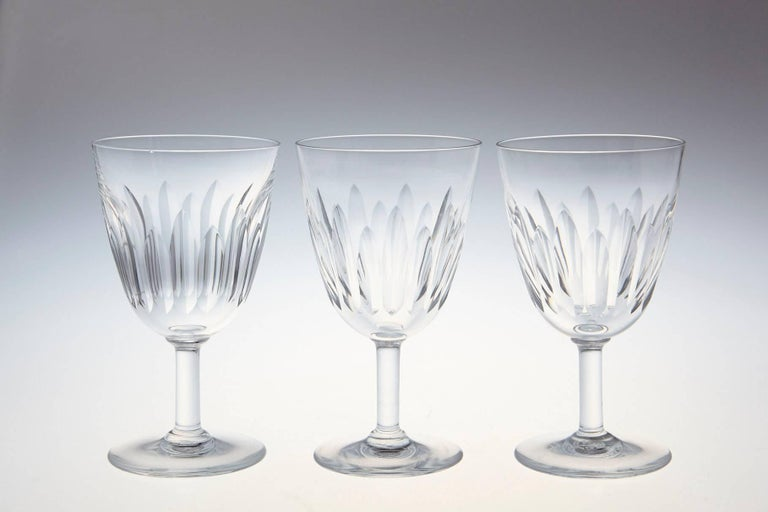 Rare set of ten Baccarat crystal white wine glasses in the 'Lorraine' pattern. The glasses are in a vertical cut bowl form with a round stem. This pattern was manufactured between 1953-1978. The glasses are in a very good condition.