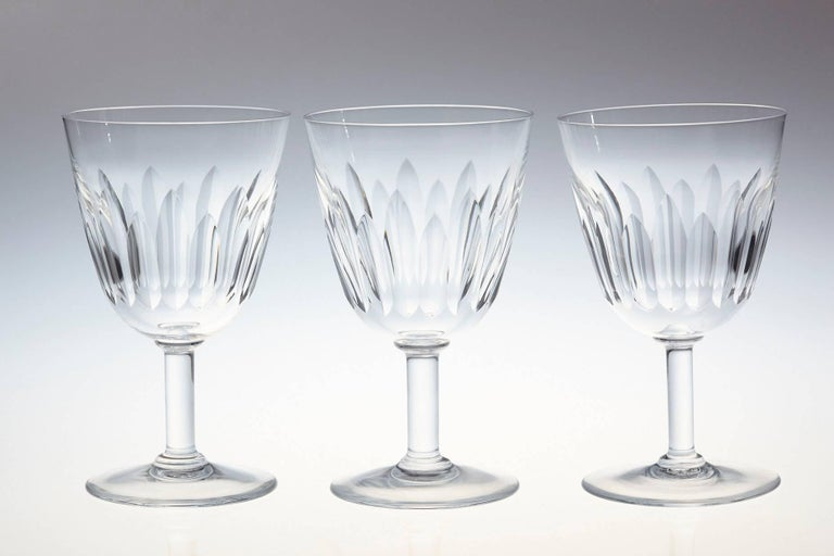 Rare set of six Baccarat crystal red wine glasses in the 'Lorraine' pattern. The glasses are in a vertical cut bowl form with a round stem.  This pattern was manufactured between 1953-1978.  The glasses are in a very good condition.