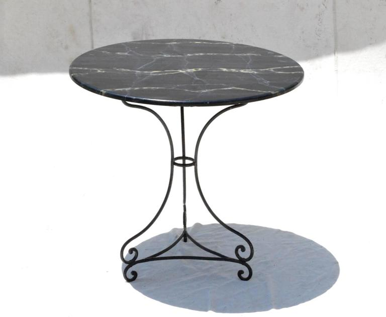 Fantastic Round Bistro Table Having Faux Marble Wood Top Resting On A Hand Wrought  Iron