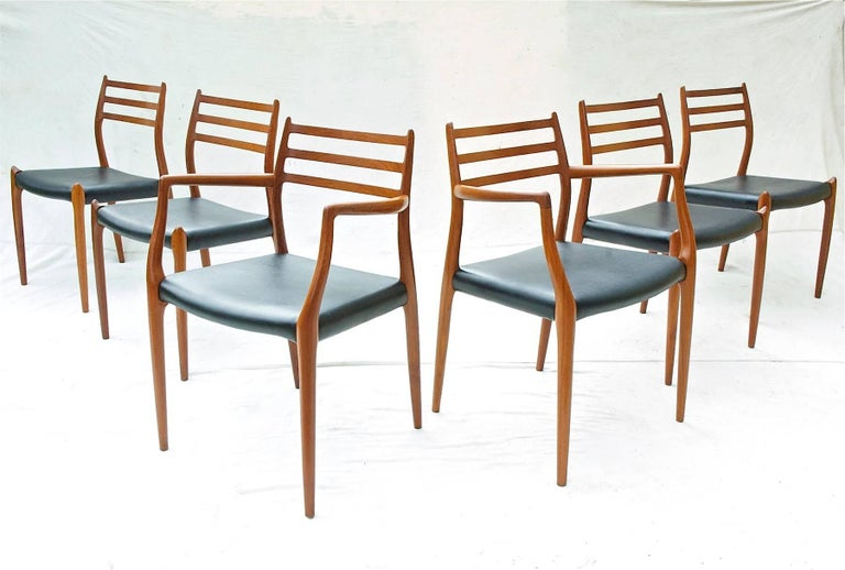 An exceptional set of Danish Modern dining chairs of teak by Niels Otto Moller. The gorgeous and sculptural chairs are comprised of four model 78 sidechairs and two model 62 armchairs. All chairs are in excellent structural condition throughout.