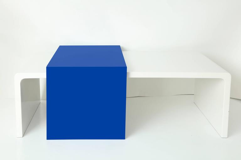 Custom coffee table with white acrylic base and Azul acrylic adjustable slider overlay top. (See additional images provided for visual presentation).