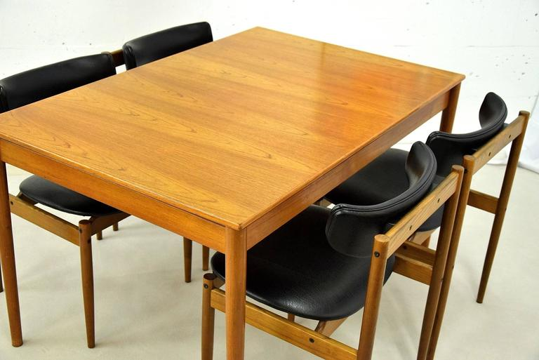Midcentury dining room table and four chairs designed by C. Denekamp and produced by Thereca in the 1960s.  Thereca started as a family business in 1907 and been producing quality furniture in the Netherlands ever since.  The set is in great