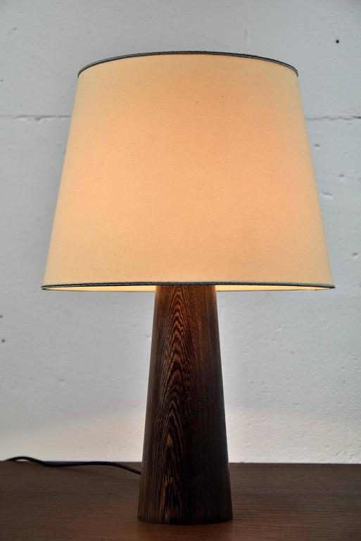 Danish, 1960s wenge table lamp.  Elegant Mid-Century table lamp made of the now protected tropical wenge wood.  Measurements: D 31 x H 46 cm.