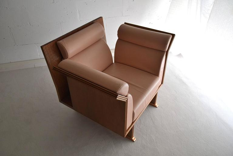 """1983 Chairs Pretenziosa by Ugo La Pietra.  """"Poltrona pretenziosa,"""" pretentious chairs designed in 1983 by Ugo La Pietra and produced in rosewood by Busnelli.  This model was part of a research on """"Neo-eclectic"""" furniture and of a"""