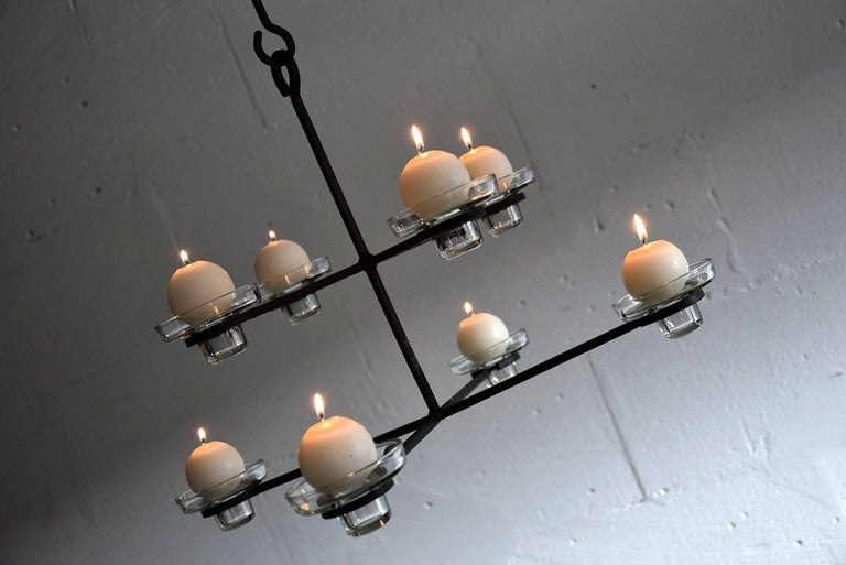 Erik Hoglund Mid-Century Modern Scandinavian chandelier  Chandelier holds eight glass candleholders.   Measurements : D.60 x H.133 adjustable. Height without the chain 34cm.  Erik Höglund is a legendary Swedish artist famous for his unique carving
