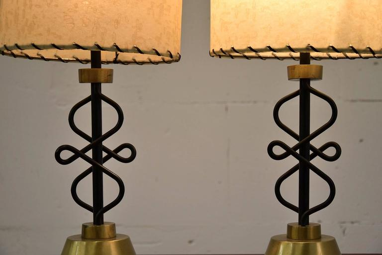 Unusual and rare Mid-Century Majestic table lamps.  Wonderful shaped body, brass feet and original parchment shades.