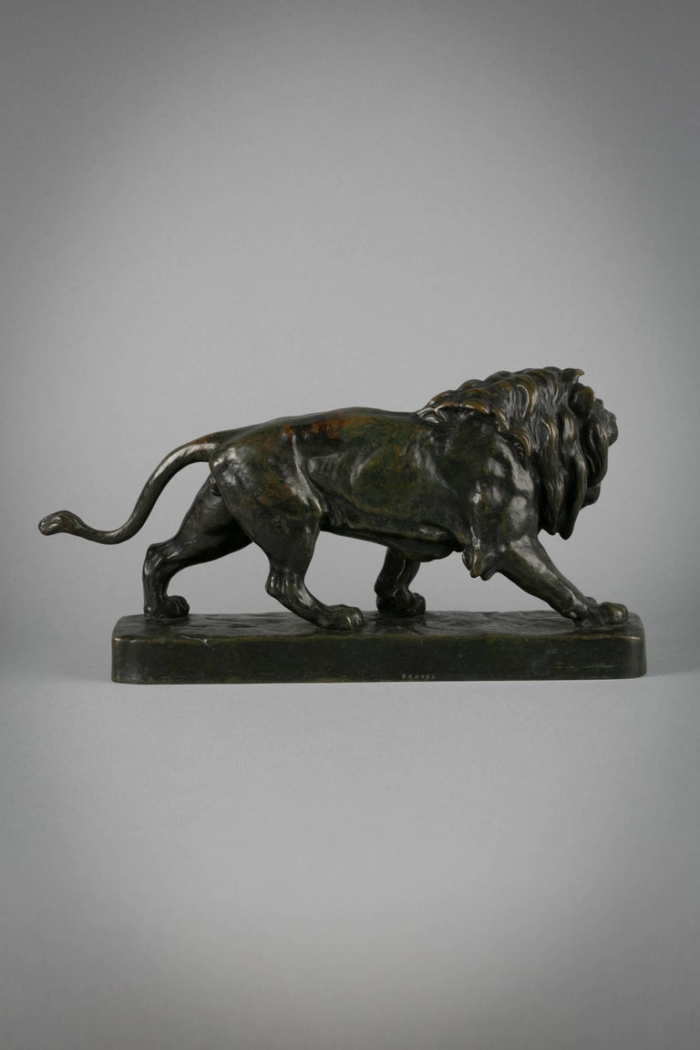 French bronze figure of a striding lion, circa 1860  Signed by Louis Vidal (1831-1892).