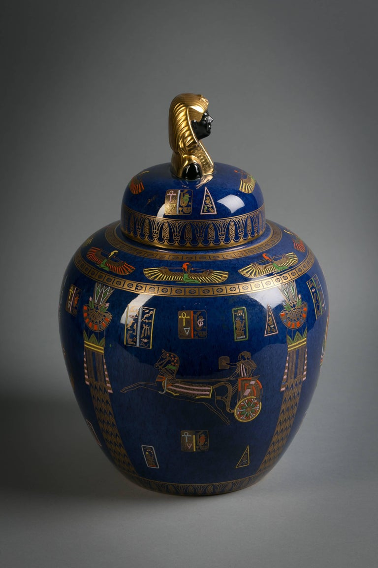 Enameled and gilt with Egyptian motifs. Printed marks in black and gilt.