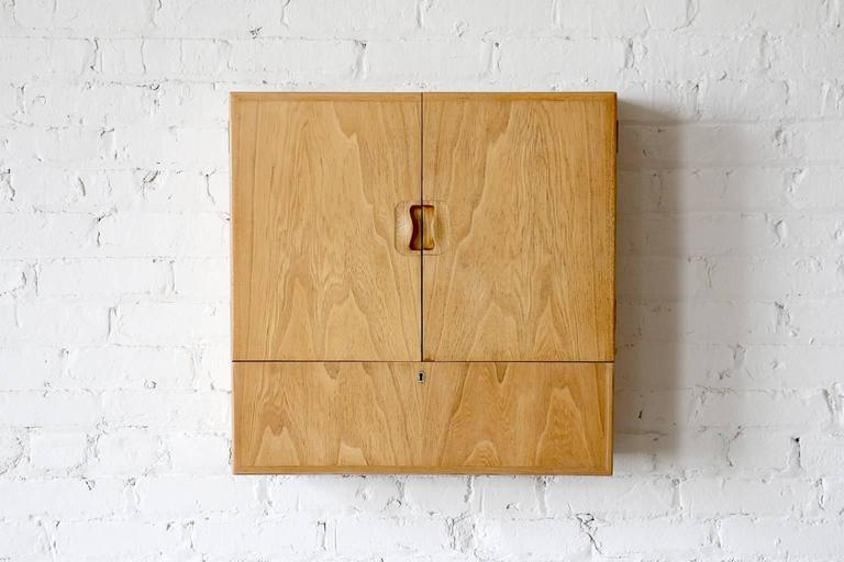 """Model """"Young Lady Wanted"""". Rarely seen design. Constructed of elm. Designed in 1941.  A rarely seen wall cabinet by Tove & Edvard Kindt-Larsen for Gustav Bertelsen. This piece was cleverly named """"Young Lady Wanted"""" and"""
