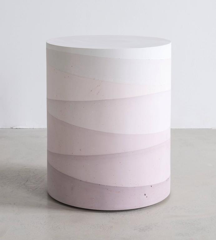 This made-to-order drum consists of hand-dyed cement, poured in layers to create an ombre watercolor effect. The piece has a hollow cavity and weighs approximately 40lbs. 4-6 weeks lead time. Custom options available, please inquire with the studio.