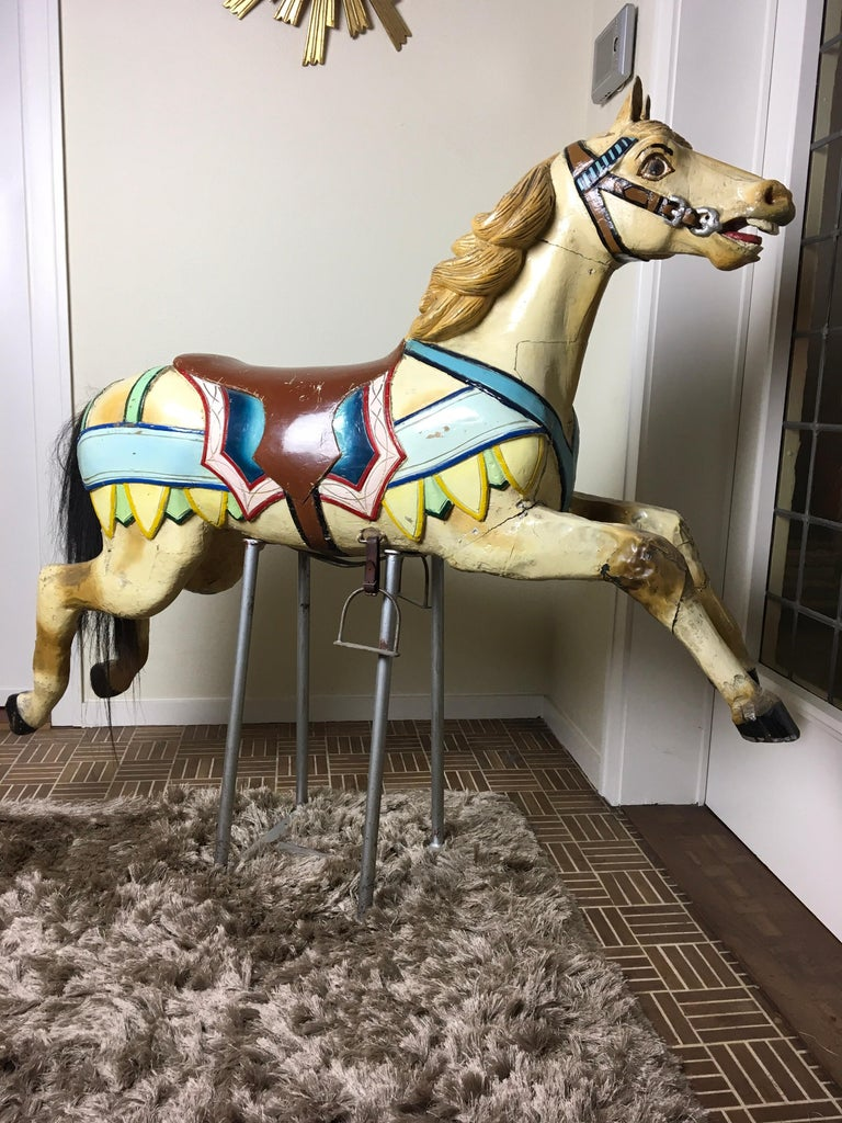 Antique handcarved wooden carousel Horse made by Atelier Hübner Germany - Josef Hübner -  Joseph Hubner.  This piece of Carnival Art - funfair roundabout horse - Merry-go-round Horse  dates circa 1910 and has sulfide eyes, real tale and stirrups.