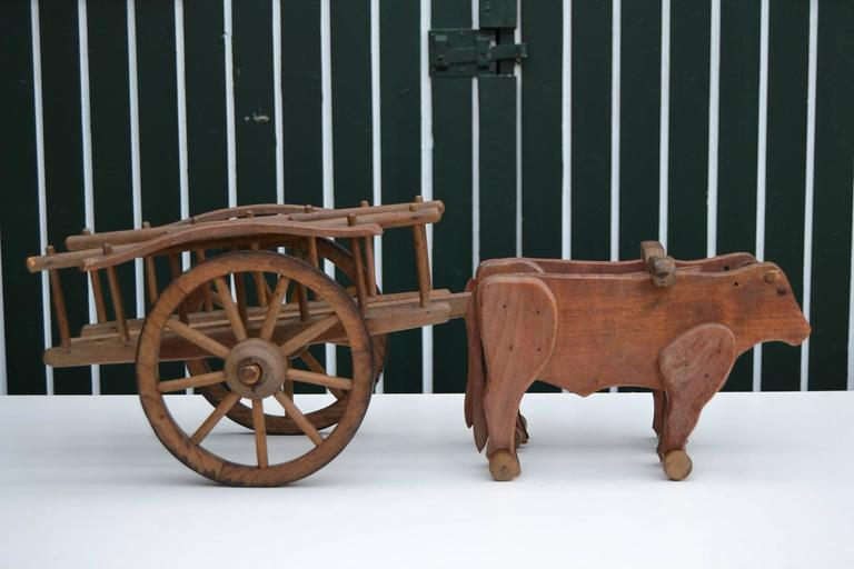 Antique French big Oak wooden Pull Toy circa 1930 by Déjou France. Length 29,52 inch  ( 75 cm ) !  Pull toy oxcart , farm wagon with two red oak cows / oxes / bullocks. In excellent condition. Rare collectable Antique Toy - miniature model