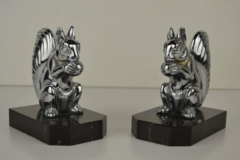 Great Set of Art Deco Bookends with Chromed Squirrels. These Cute Chromed Squirrels are mounted on Marble Bases.  They have a Modern Look - Modern Style.  Animal Figurine - Animal Sculpture - Animal Bookends.