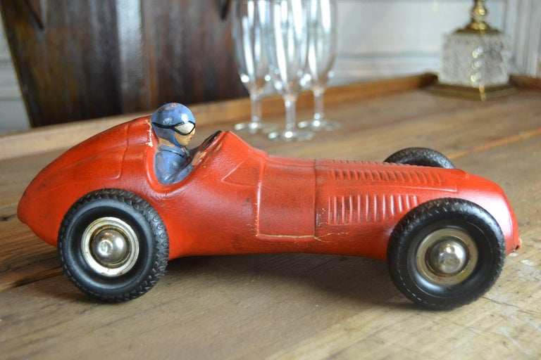 Vintage thick Red Rubber Racing Toys Car from the 1930s.