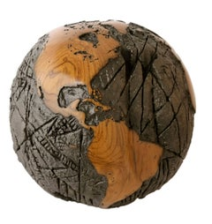 Wooden globe made of teak root and metal with cold lava flow texture, 30 cm