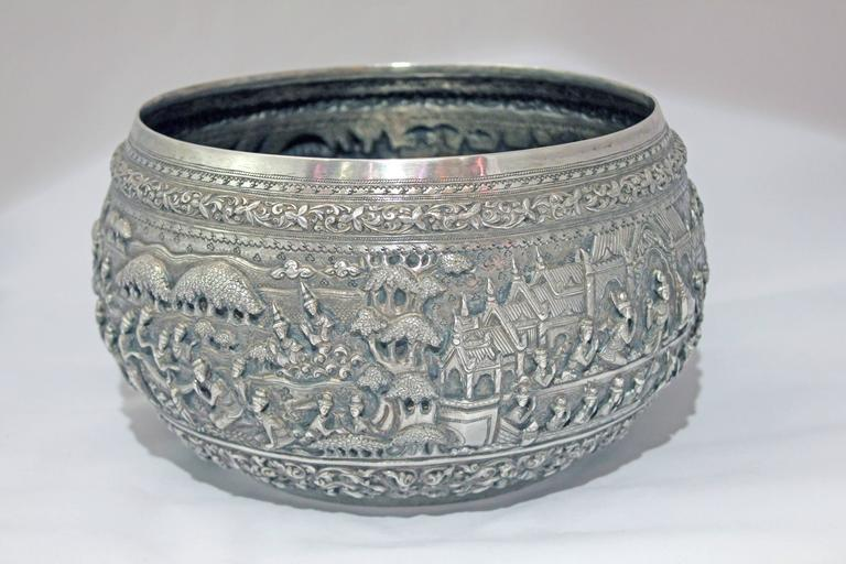 The silver bowl with finely chased details in high relief depicts scenes from the Jataka tales. These tales are moralistic tales, either from the lives of the Buddha or parables taught by Buddha. The rim and the base of the bowl are   finely
