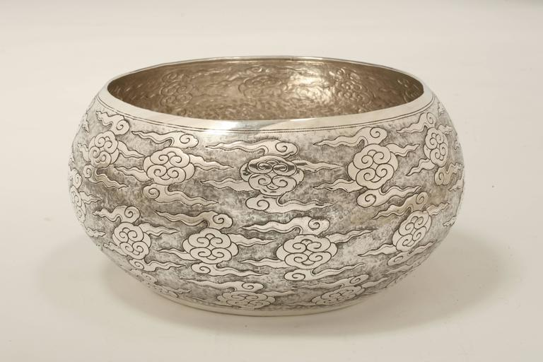 The large contemporary solid silver bowl is finely chased with ruyi (As-you-wish symbol) cloud motif and available in other sizes.