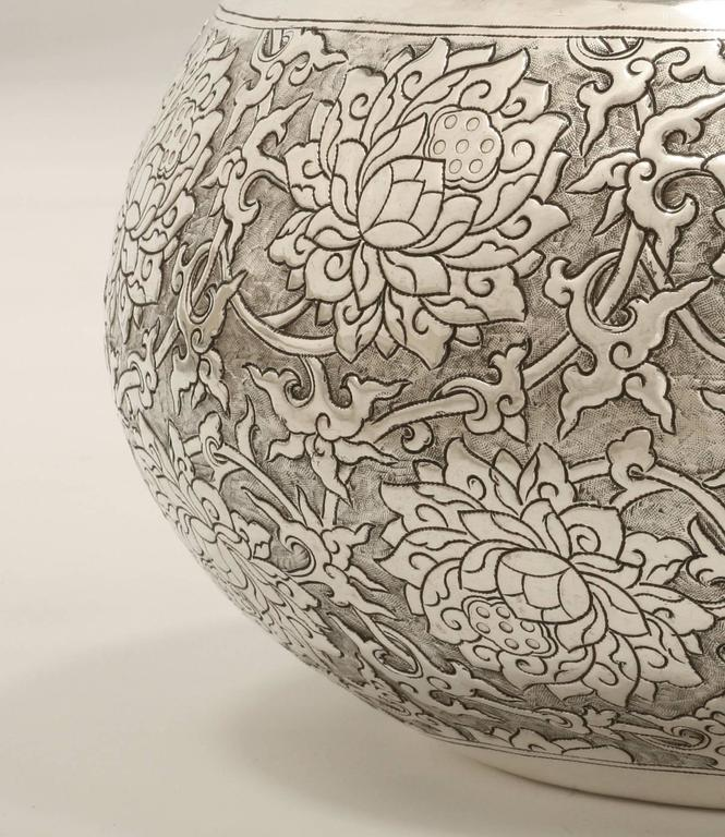 The large contemporary solid silver bowl is finely chased with scrolling lotus motif (elegance and purity symbol), and available in other sizes. The silver is 90% pure.