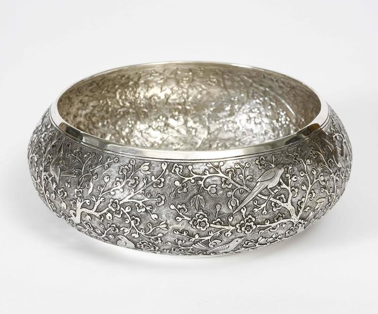The fine solid silver bowl is chased with meticulous motif of blossom and birds. The bowl is available in other sizes. The silver is 90% pure.