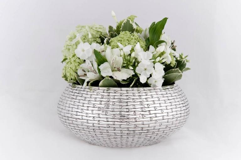 A contemporary solid silver bowl, finely chased with bamboo motif The silver is 90% pure.