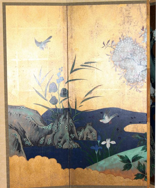 The spring scene painting of this six-panel screen is hand-painted in watercolor, on squares of gold leaf which are applied by hand to the paper base over carefully jointed wooden lattice frames. Lacquer rails are then applied to the perimeter to