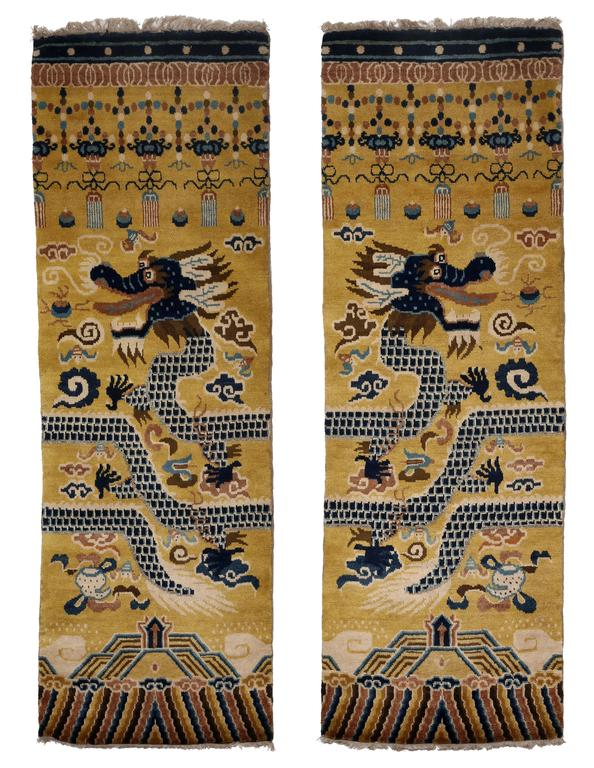 The fine pair of pillar carpets is hand-knotted and woven in the Ningxia style. The autonomous Province of Ningxia shares borders with Mongolia and has a mainly Muslim population thus giving it a rich carpet tradition and access to superb wool. This