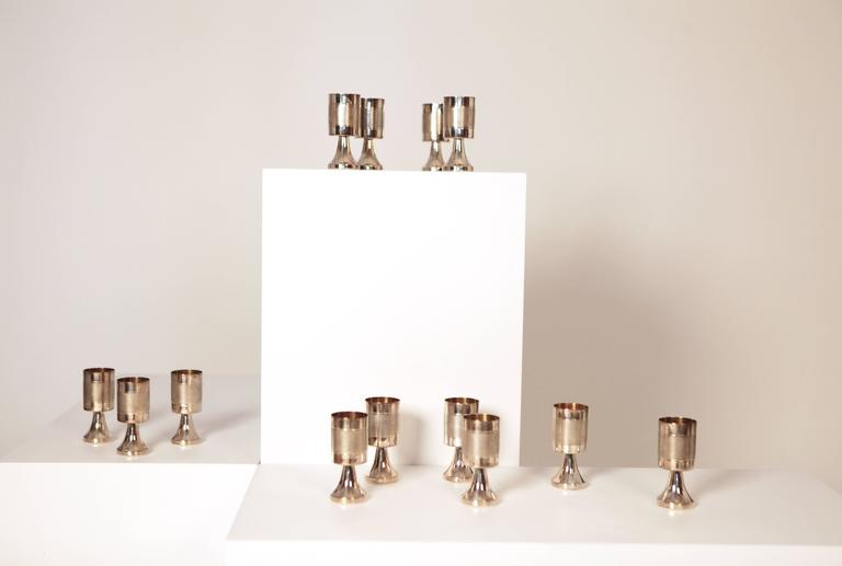 A set of 13 gilded and sterling silver champagne or wine cups. manufactured in1978 for Alton, Falköping, Sweden. approximate, 1700gr. stamped.