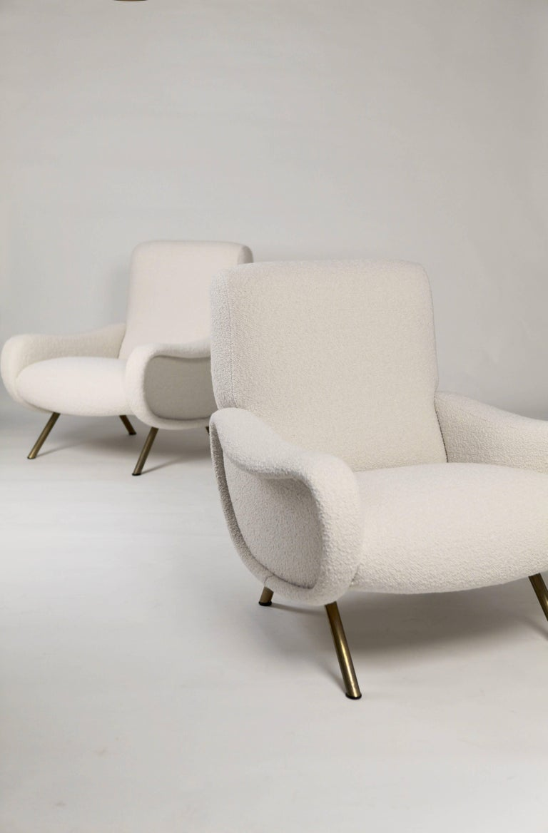 Excellent pair of 'Lady' armchairs by Marco Zanuso, very early 'Arflex' edition with wooden frame, Italy, circa 1951 New upholstery, original rubber shoes.