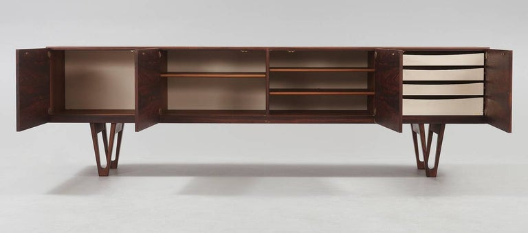 Sideboard by Ib Kofod-Larsen for Säffle Möbelfabrik, Sweden, 1958.  Beautiful Palisander sideboard designed by the Danish designer Ib Kofod-Larsen, produced by the Swedish manufacturer Säffle Möbelfabrik. This rare and very sought after model