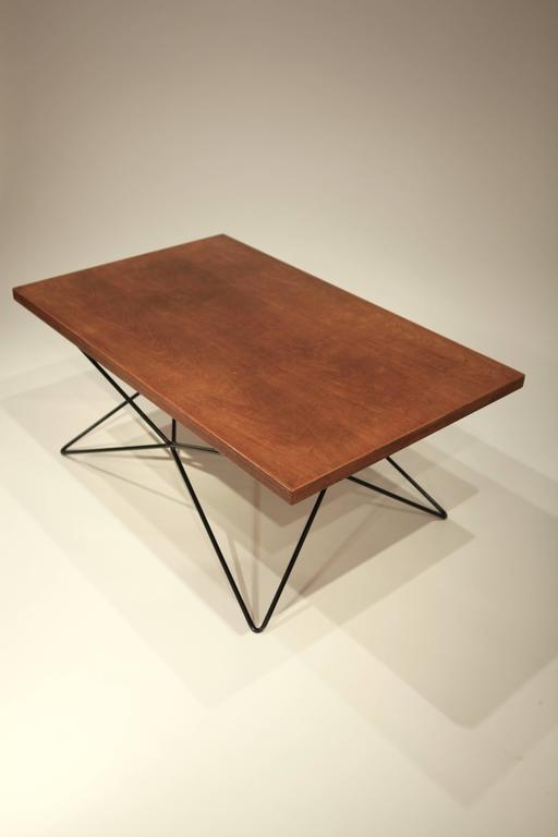 Teak top and black painted iron base coffee table. Bengt Johan Gullberg, Sweden, 1950s. Adjustable in 3 height positions by turning the base.