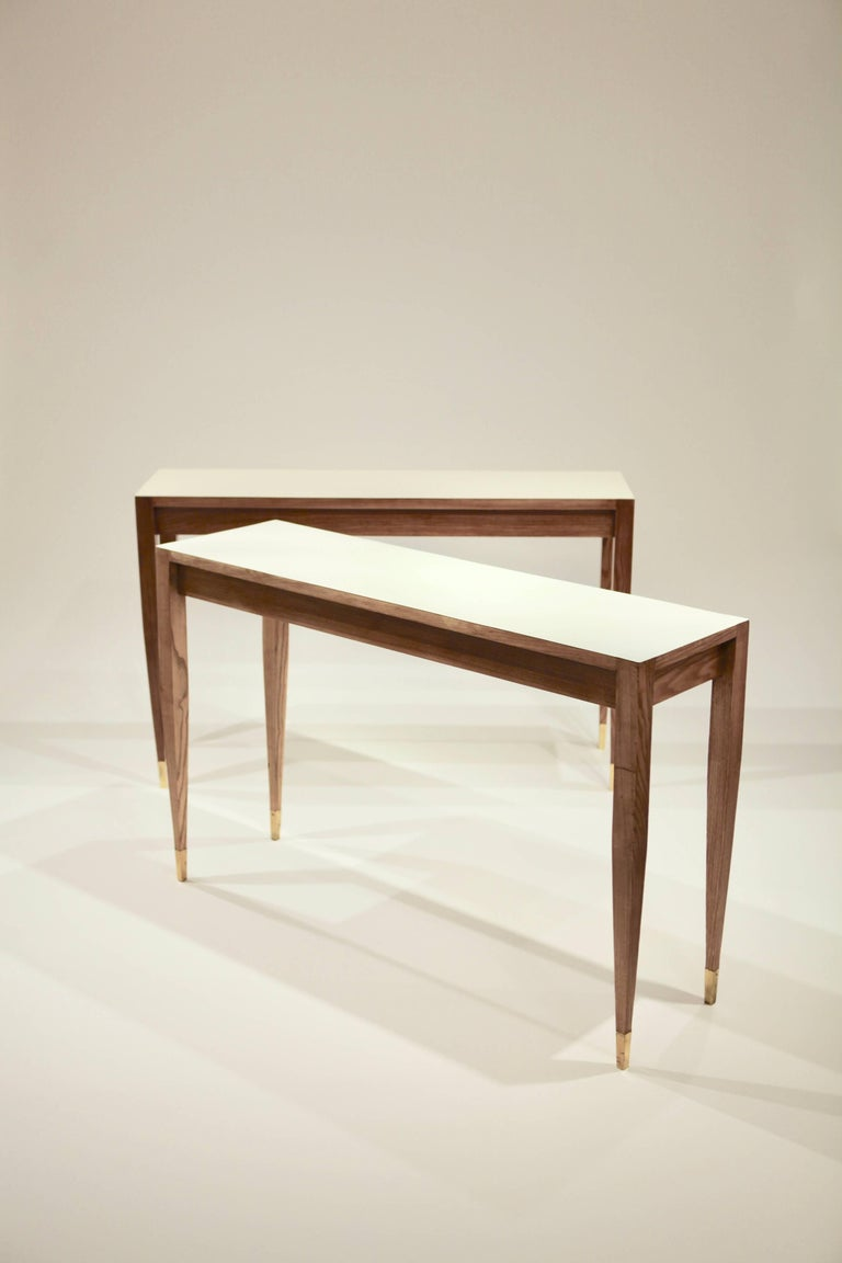 A pair of console tables by Gio Ponti,  Manufactured for the Parco dei Principe Hotel Sorrento, circa 1961 Ash Formica Brass