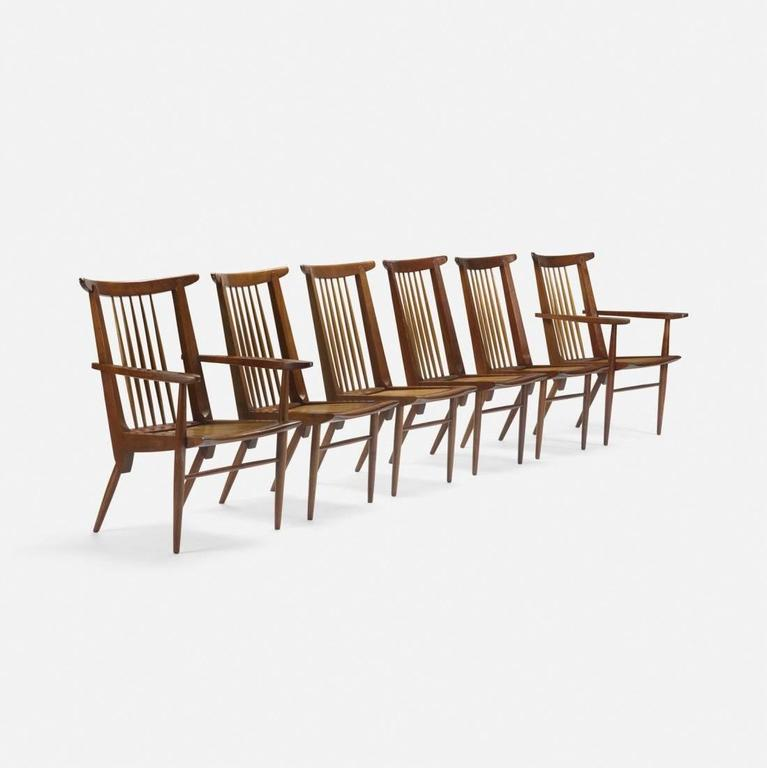George Nakashima.  A set of six black walnut and hickory dining chairs.  The chairs were crafted by Widdicomb furniture in Grand Rapids, MI. They are rare and exeptional examples of George Nakashima´s earliest work. Stunning quality