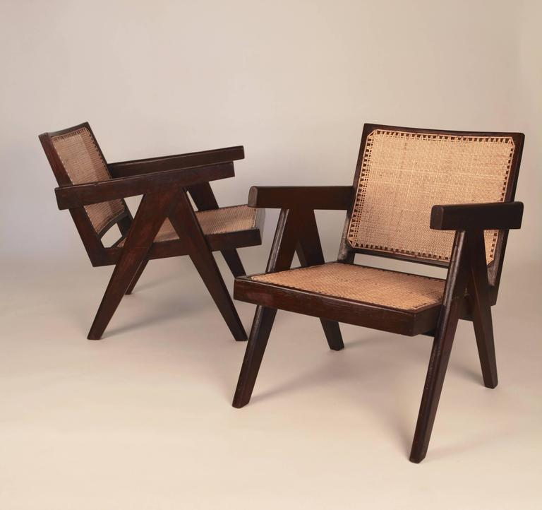 Pierre Jeanneret.  Pair of easy armchairs,  stained teak and cane.  Provenance: Chandigarh, India, 1955.  Literature: Le Corbusier Pierre Jeanneret, Chandigarh, India.  Galereie Patrick Seguin, pg. 176, 283.  Le Corbusier Pierre