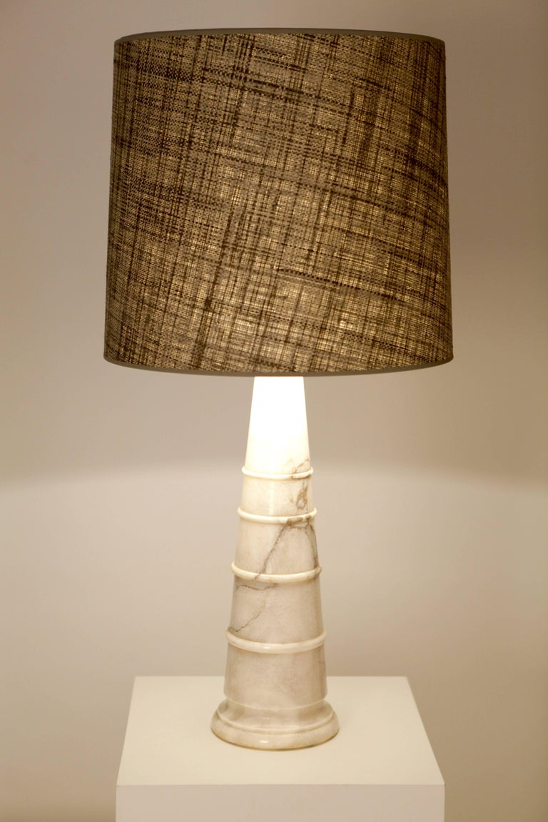 A large and fine carved Italian white marble cone shaped table lamp, rewired and handmade Raffia-shade with diffuser. Excellent condition.  Italy, 1970s.