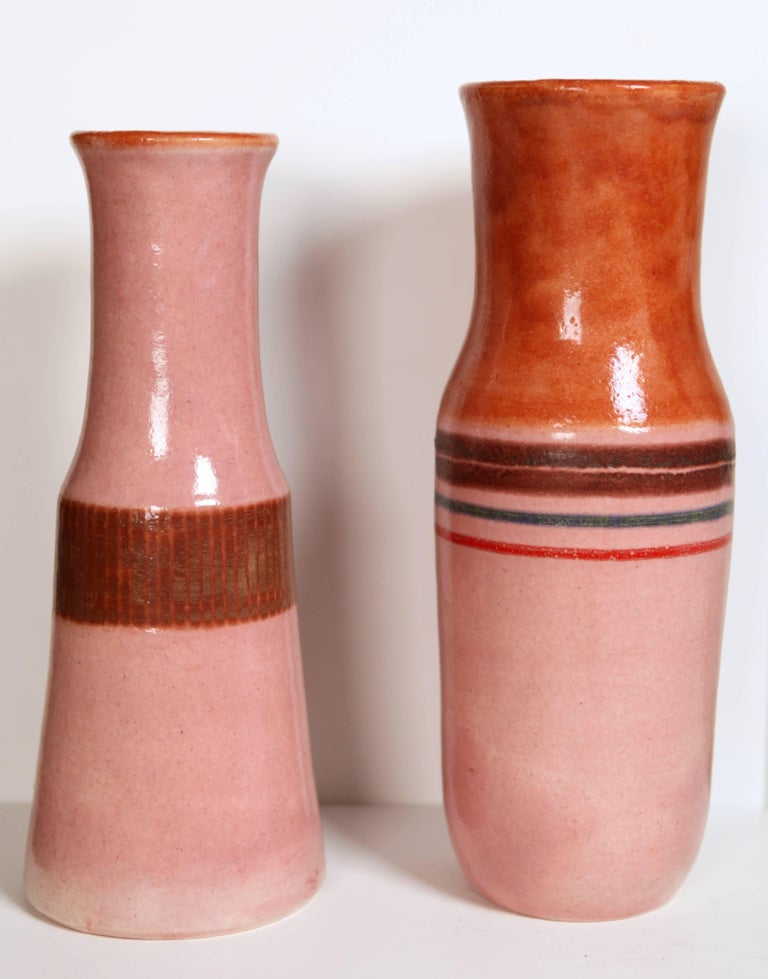Bruno Gambone (*1936) Two vases, ceramic glazed Limited edition created in 1969 and 1979 Italy signed: Gambone, Italy, to the underside Measure: left height 32cm x 12.5 cm diameter right height 34cm x 12.5 cm diameter.