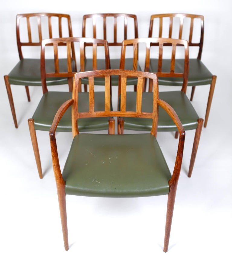 Set of six dining chairs ( Model 66 and 83) in East Indian rosewood and green leather, designed by Niels O. Møller in 1974,