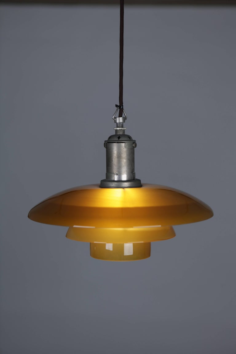 Poul Henninsen, 3 1/2 /3 Amber Colored Glass Pendent Ceiling Light, 1927 In Excellent Condition For Sale In Hamburg, Hamburg
