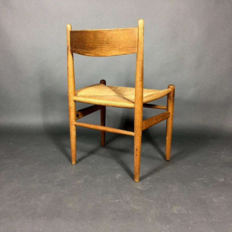 A lovely vintage set of six dining chairs in solid oak and woven papercord designed by Hans J. Wegner in 1962, Model CH36, Denmark. In excellent vintage condition - no breaks to woven papercord.