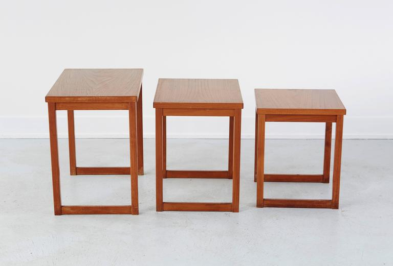 A set of three Kai Kristiansen nesting tables. Teakwood in excellent condition. Use as a coffee table, side table or nightstands. Measurement indicates largest of the three tables.