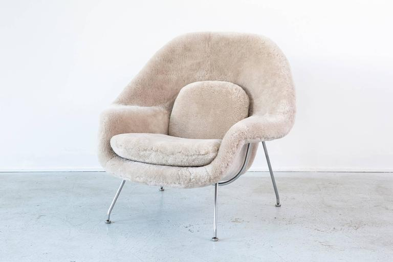 Womb chair  designed by Eero Saarinen for Knoll,  USA, d 1948 / circa 1960s.  Reupholstered in shearling and steel frame.  Measures: 35 ½