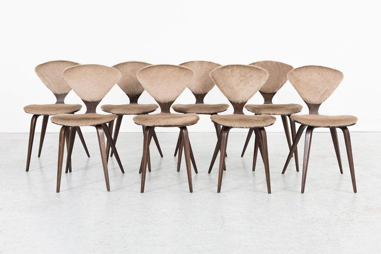"""Set of eight dining chairs  Designed by Norman Cherner for Plycraft  USA, circa 1960s  Reupholstered in Italian cowhide with refinished wood   Measures: 32 3/16"""" H x 17"""" W x 21 ?"""" D x seat 19 1/16"""" H  Original labels are intact  Sold as a"""