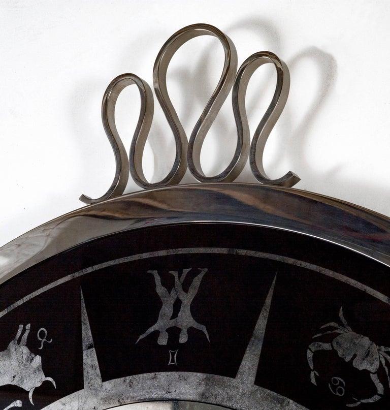 Round Zodiac mirror Mirrored centre panel with silver leaf églomisé astrological figures Measure: H 42 1/2