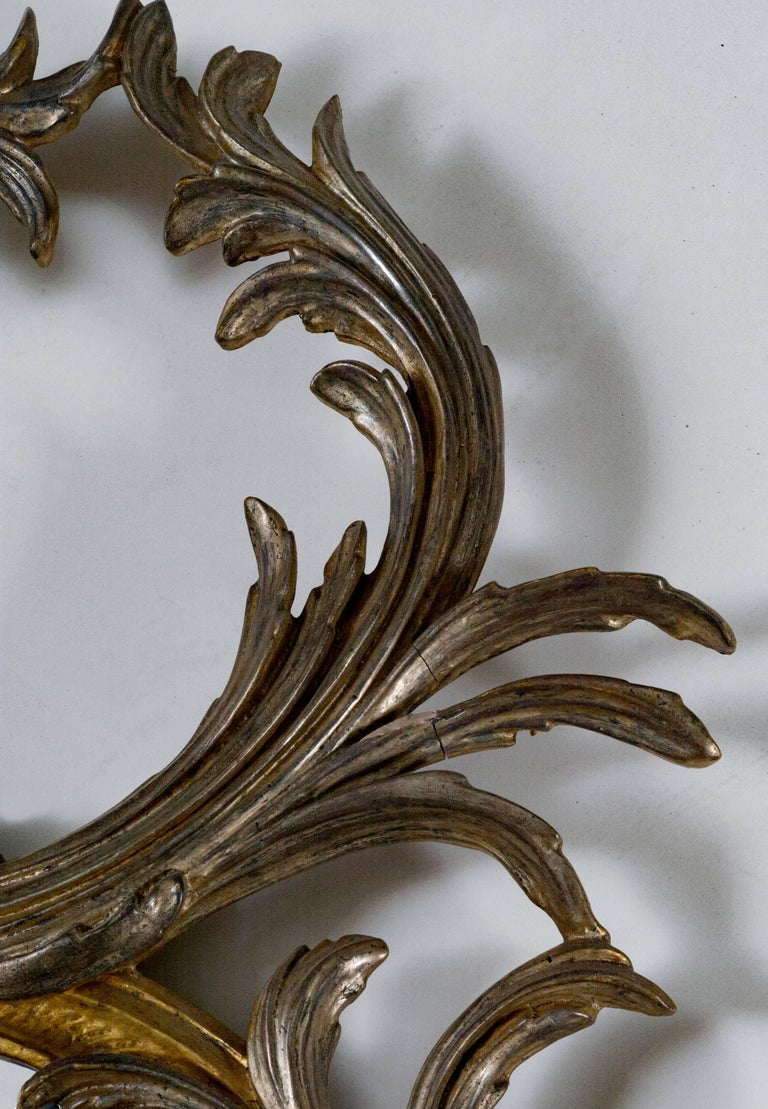 Oval silver and gold metal leaf frame with bevel